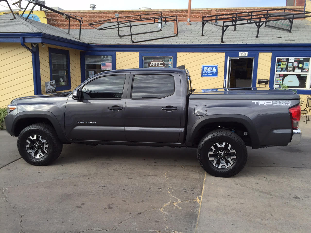 Chevy Colorado Off Road Accessories 2016-Toyota-Tacoma-ARE-lid-profile - Suburban Toppers