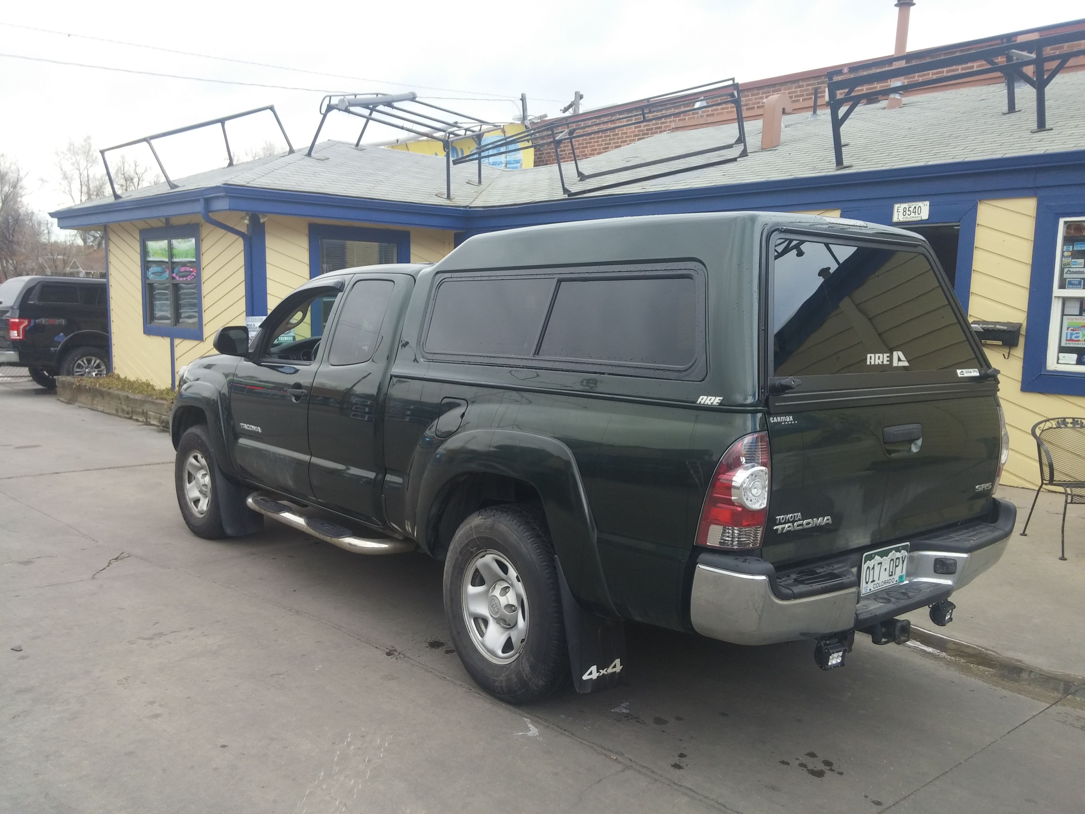 Toyota Tacoma Green Mx Topper Denver Suburban Toppers